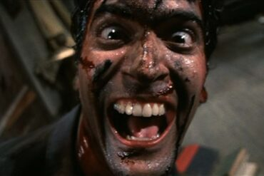 Bruce Campbell laughing in Evil Dead